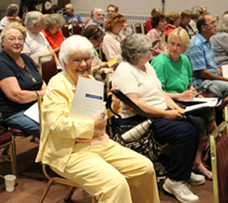A senior citizen at the college enjoys one of the many classes as she sits in the audience