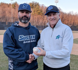 Coach Mehmedi and Athletic Director Kuntz stand holding a baseball.
