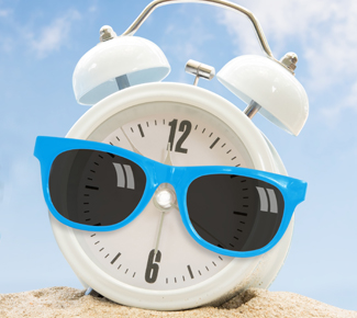 White clock in the sand wearing blue sunglasses.