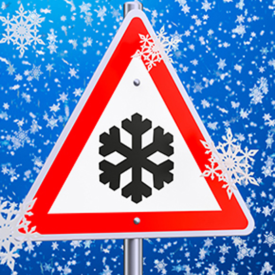 Graphic image of snow falling with a triangle sign and snow flake inside.